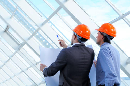 20706852 - two men in hard hats at construction site